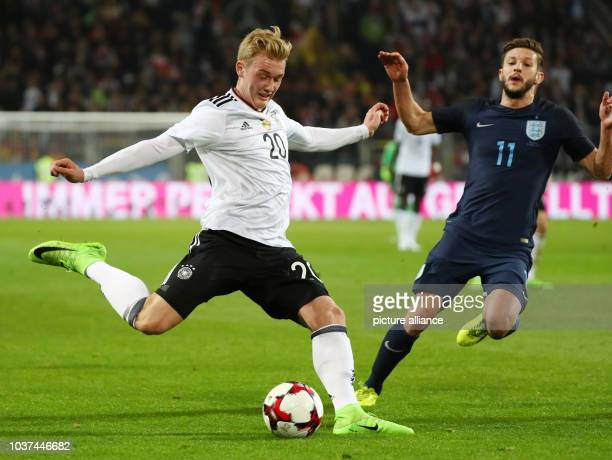 Germany's Julian Brandt and England's Adam Lallana vie for the ball during the international match between Germany and England at Signal Iduna Park...