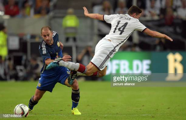 Germany's Julian Draxler and Argentina's Pablo Zabaleta vie for the ball during the international soccer match between Germany and Argentina at...