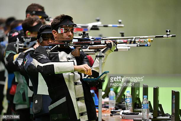Germany's Julian Justus competes during the men's 10m Air Rifle at the Olympic Shooting Centre in Rio de Janeiro on August 8 during the Rio 2016...