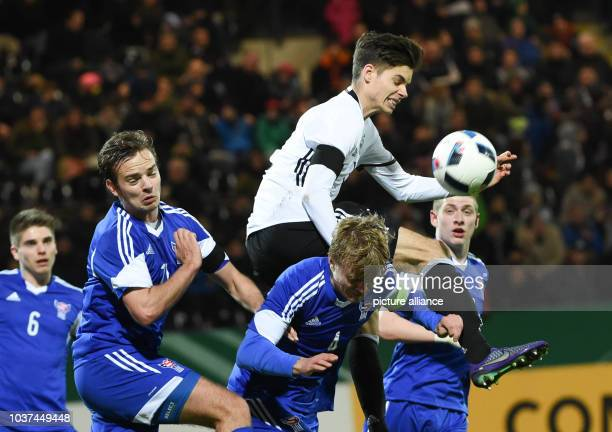Germany's Julian Weigl in action against Faroe Islanders Jonas Gejel Hansen Gestur Dam Andrias Eriksen and Teit Jacobsen during the European...