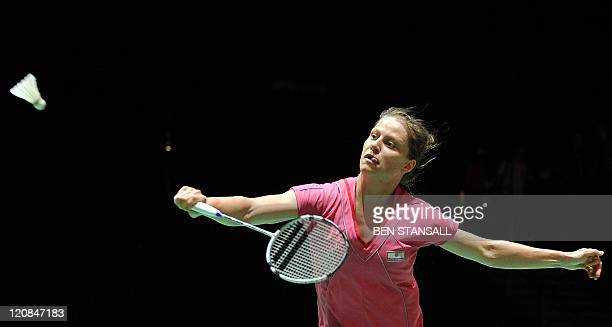 Germany's Juliane Schenk returns a shot to China's Jiang Yanjiao during round 16 of the women's singles in the World Badminton Championships at...