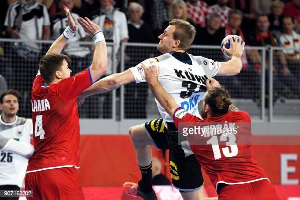 Germany's Julius Kuhn vies with Czech Republic's Jan Landa and Pavel Horak during the group II match of the Men's 2018 EHF European Handball...