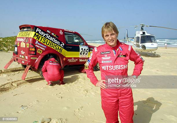 Germany's Jutta Kleinschmidt on the beach after she became the first woman to win the gruelling Paris-Dakar rally 21 January 2001 in Dakar after...
