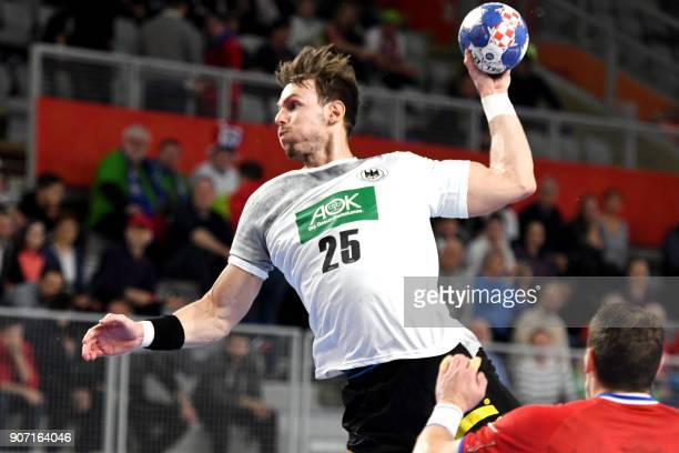 Germany's Kai Hafner tries to score over Czech Republic's Tomas Cip during the group II match of the Men's 2018 EHF European Handball Championship...