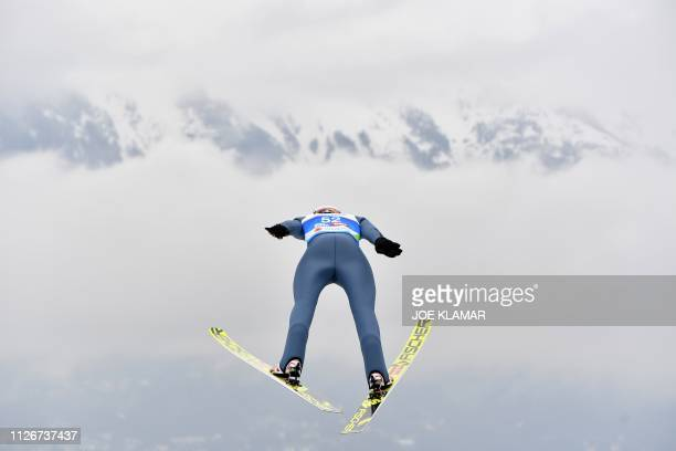 TOPSHOT Germany's Karl Geiger soars in the air during his trial jump before the Ski Jumping event at the FIS Nordic World Ski Championships at...