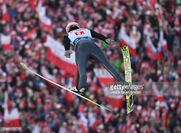 Germany's Karl Geiger soars through the air during the men's team event at the FIS Ski Jumping World Cup competition on January 19 2019 in Zakopane...
