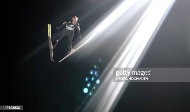 Germany's Karl Geiger soars through the air during the qualification jump at the fourth stage of the Four Hills Ski Jumping tournament in...