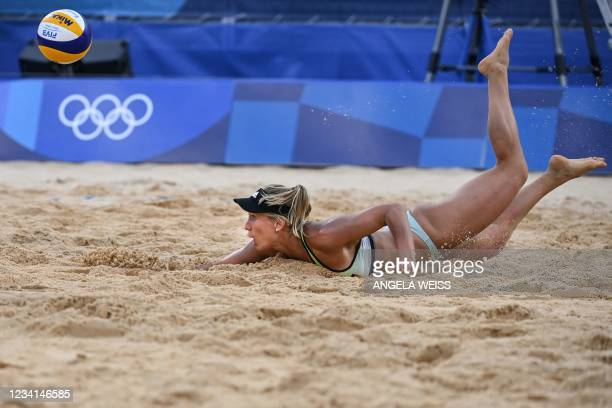 Germany's Karla Borger dives for the ball in their women's preliminary beach volleyball pool A match between Switzerland and Germany during the Tokyo...