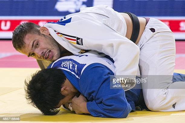 Germanys KarlRichard Frey competes with Japans Ryunosuke Haga during the mens gold medal match in the 100kg category at the Judo World Championships...