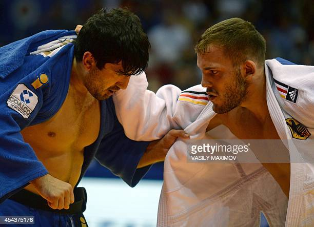Germany's KarlRichard Frey competes with Russia's Tagir Khaibulaev during the 100kg category competition at the World Judo Championships in...
