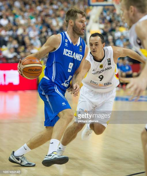 Germany's Karsten Tadda and Iceland's Jon Stefansson vie for the ball during the European Championship basketball match between Germany and Iceland...