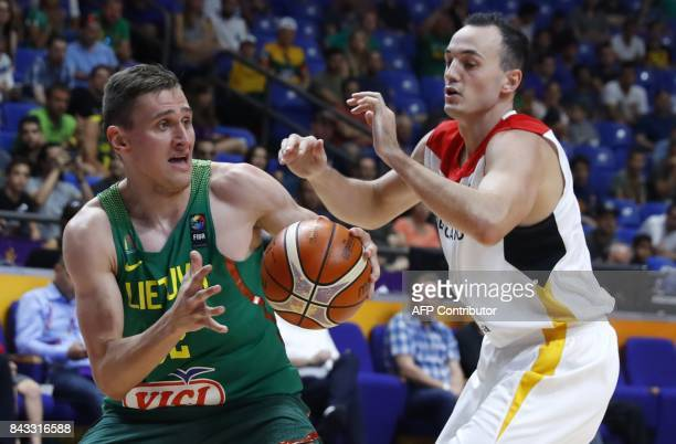 Germany's Karsten Tadda vies with Lithuania's Edgaras Ulanovas during the FIBA EuroBasket 2017 championship match between Germany and Lithuania at...
