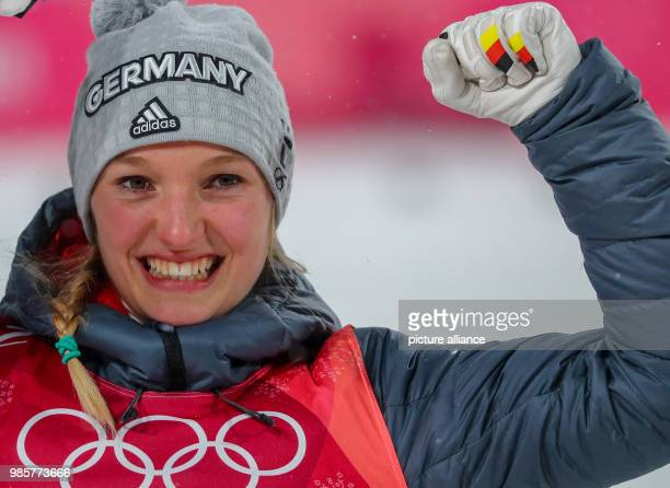 Germany's Katharina Althaus celebrates winning the silver medal at the women's ski jumping event at Alpensia Ski Jump Centre during the Olympic...