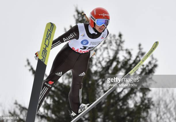 Germany's Katharina Althaus compets to win the Ladies' FIS World Cup Ski Jumping event in Rasnov Romania on March 3 2018 / AFP PHOTO / Daniel...