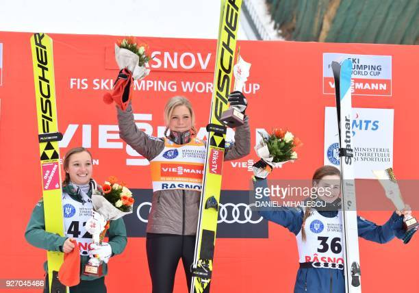 Germany's Katharina Althaus Maren Lundby of Norway and Nika Kriznar of Slovenia pose on the podium after the Ladies' HS97 ski jumping event of the...