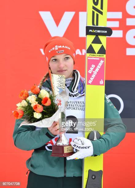 Germany's Katharina Althaus poses on the podium after placing second in the Ladies' HS97 ski jumping event of the Ladies' FIS World Cup Ski Jumping...