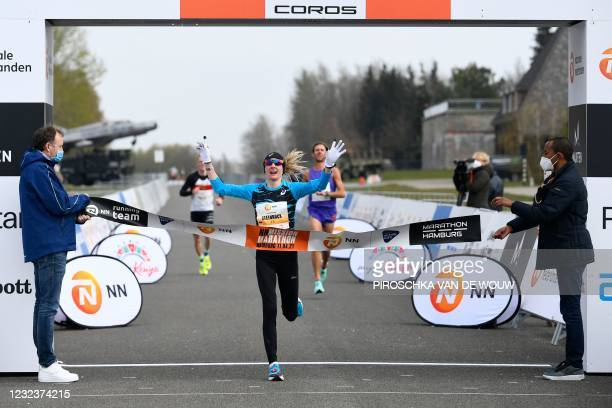 """Germany's Katharina Steinrueck crosses the finish line to win the """"Hamburg Marathon"""" taking place at the Twente airport in Enschede, the Netherlands..."""