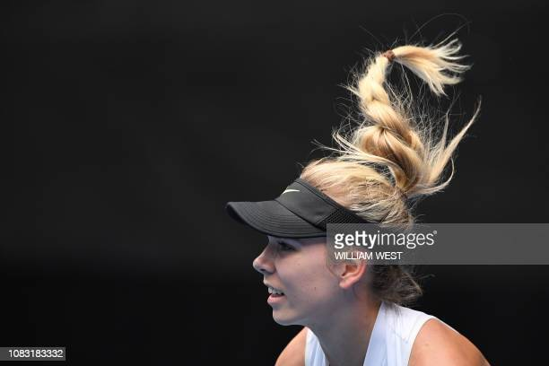 Germany's Katie Boulter hits a return against Belarus' Aryna Sabalenka during their women's singles match on day three of the Australian Open tennis...