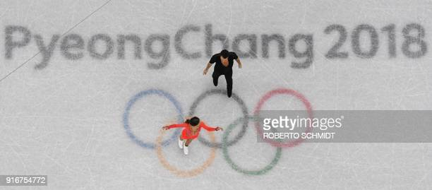 Germany's Kavita Lorenz and Germany's Joti Polizoakis compete in the figure skating team event ice dance short dance during the Pyeongchang 2018...