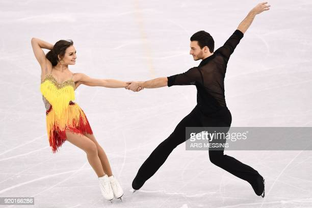 TOPSHOT Germany's Kavita Lorenz and Germany's Joti Polizoakis compete in the ice dance short dance of the figure skating event during the Pyeongchang...