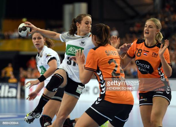 Germany's Kerstin Wohlbold vies with Netherland's Martine Smeets und Kelly Dulfer during the preliminary round IHF Womens World Championship handball...