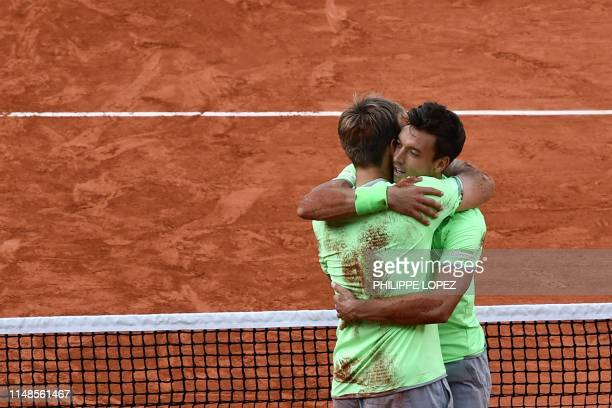 Germany's Kevin Krawietz and Germany's Andreas Mies hug as they celebrate after winning against France's Jeremy Chardy and France's Fabrice Martin at...