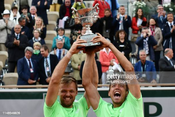 Germany's Kevin Krawietz and Germany's Andreas Mies pose with the Jacques Brugnon Cup after winning against France's Jeremy Chardy and France's...