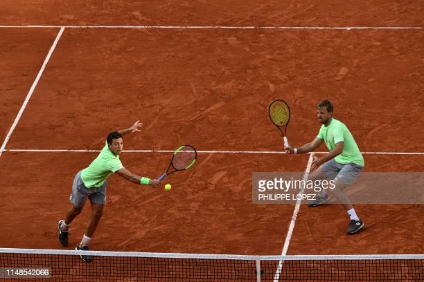 Germany's Kevin Krawietz and Germany's Andreas Mies return the ball to France's Jeremy Chardy and France's Fabrice Martin during their men's doubles...