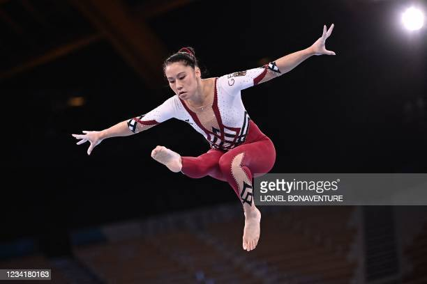 Germany's Kim Bui competes in the artistic gymnastics balance beam event of the women's qualification during the Tokyo 2020 Olympic Games at the...