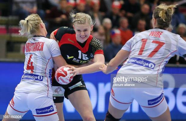 Germany's Kim Naidzinavicius and Norway's Veronika Kristiansen and Pernille Wibe vie for the ball during the World Women's Handball Championship...