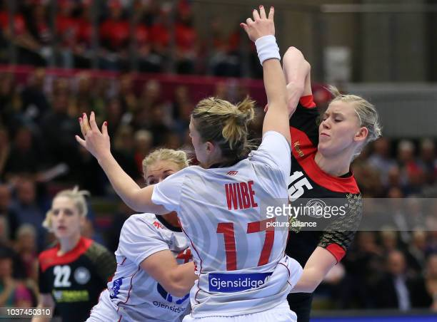 Germany's Kim Naidzinavicius and Norways's Pernille Wibe vie for the ball during the World Women's HandballChampionship match between Germany and...