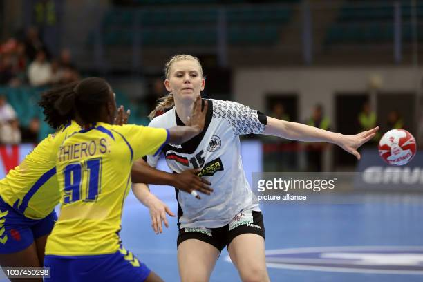 Germany's Kim Naidzinavicius in action against the Congo's Simone Thiero during a handball match between Germany and the DR Congo at the IHF Women's...