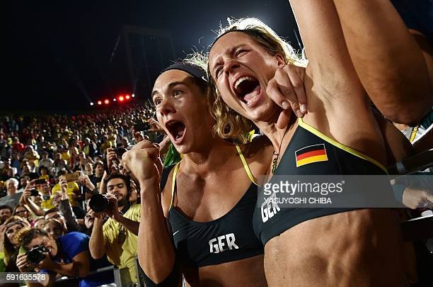 TOPSHOT Germany's Kira Walkenhorst and Laura Ludwig celebrate after winning the women's beach volleyball final match between Brazil and Germany at...