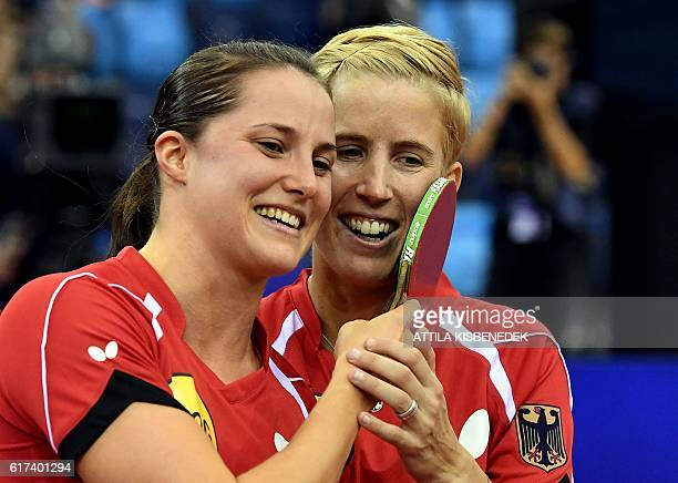 Germany's Kristin Silbereisen and Sabine Winter celebrate winning against Germany's Xiaona Shan and Petrissa Solja in Budapest on October 23 2016...