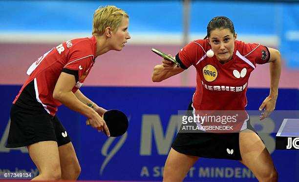 Germany's Kristin Silbereisen and Sabine Winter return against Germany's Xiaona Shan and Petrissa Solja in Budapest on October 23 2016 during the...