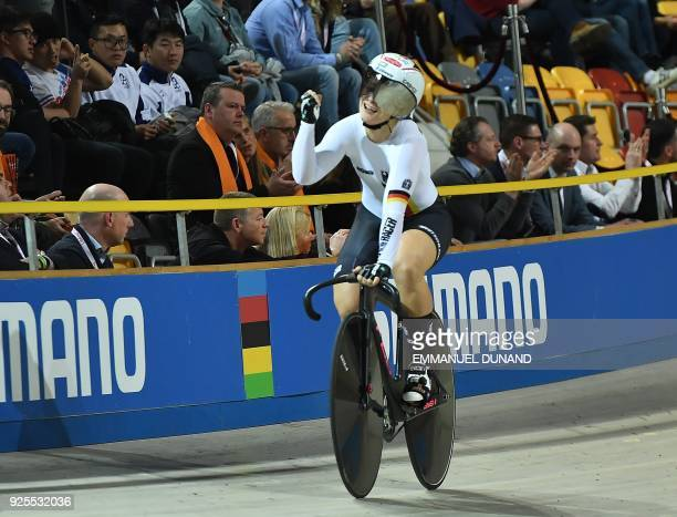 Germany's Kristina Vogel celebrates after victory in the women's team sprint final race at The UCI World Cycling Championships in Apeldoorn on...