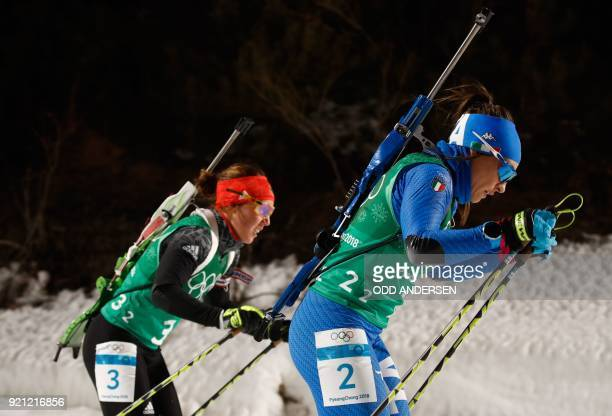 Germany's Laura Dahlmeier and Italy's Dorothea Wierer compete in the mixed relay biathlon event during the Pyeongchang 2018 Winter Olympic Games on...