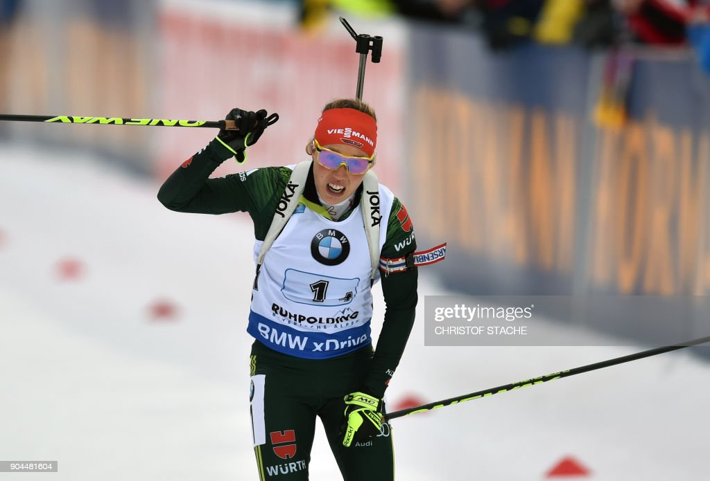 Germany's Laura Dahlmeier celebrates after winning the women's 4 x 6 km relay event of the Biathlon World Cup on January 13, 2018 in Ruhpolding, southern Germany. Germany won the event ahead of Italy (2nd) and Sewden (3rd). /