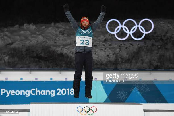 TOPSHOT Germany's Laura Dahlmeier celebrates during the victory ceremony after taking first place in the women's 75 km sprint biathlon event during...
