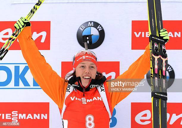 Germany's Laura Dahlmeier celebrates her gold medal on the podium of the women's 125 km mass start event of the Biathlon Word Cup in the Siberian...