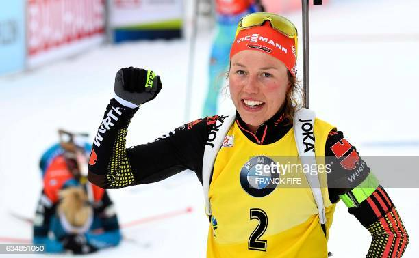 Germany's Laura Dahlmeier celebrates in the finish area of the Women's 10 km pursuit race during the 2017 IBU World Championships Biathlon in...