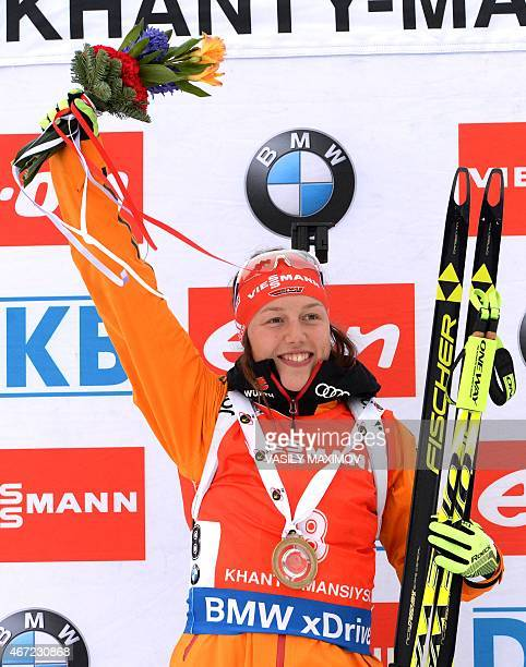 Germany's Laura Dahlmeier celebrates on the podium after the women's 125 km mass start event of the Biathlon Word Cup in the Siberian city of...