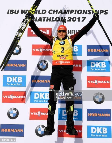 Germany's Laura Dahlmeier celebrates on the podium of the Women's 10 km pursuit race during the 2017 IBU World Championships Biathlon in Hochfilzen,...