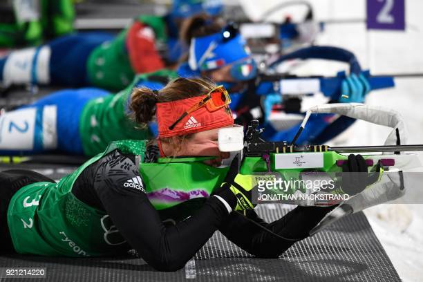 Germany's Laura Dahlmeier competes at the shooting range in the mixed relay biathlon event during the Pyeongchang 2018 Winter Olympic Games on...