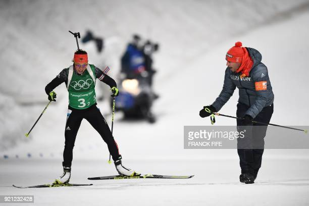 Germany's Laura Dahlmeier competes in the mixed relay biathlon event during the Pyeongchang 2018 Winter Olympic Games on February 20 in Pyeongchang /...
