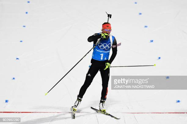 Germany's Laura Dahlmeier crosses the finish line in the women's 4x6km biathlon event during the Pyeongchang 2018 Winter Olympic Games on February 22...