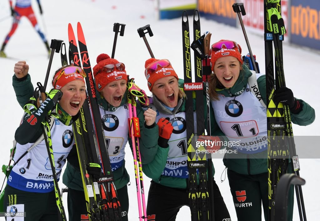 Germany's Laura Dahlmeier, Franziska Hildebrand, Denise Herrmann and Franziska Preuss celebrate after winning the women's 4 x 6 km relay event of the Biathlon World Cup on January 13, 2018 in Ruhpolding, southern Germany. Germany won the event ahead of Italy (2nd) and Sewden (3rd). /