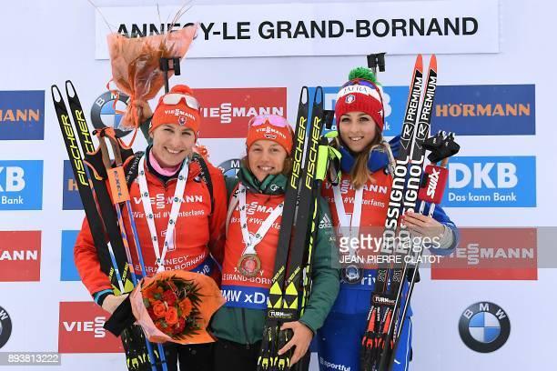 Germany's Laura Dahlmeier poses on the podium with second place Slovakia's Anastasiya Kuzmina and third place Italy's Lisa Vittozzi after she won the...