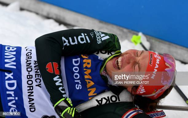 Germany's Laura Dahlmeier reacts after crossing the finish line to secure second place during the event women's 75 km sprint event at the IBU World...