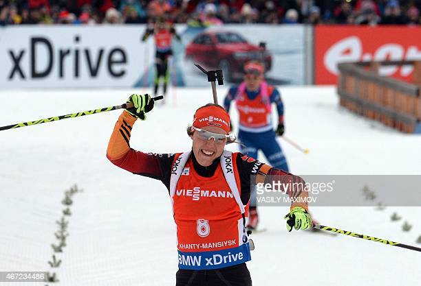 Germany's Laura Dahlmeier reacts as she crosses the finish line during the women's 125 km mass start event of the Biathlon Word Cup in the Siberian...
